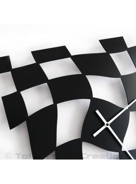 Close-up of the design wall clock Twister. Height 40 cm. Steel laser cut.