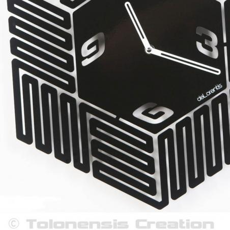 A close-up of the design wall clock Maze. Height 40 cm