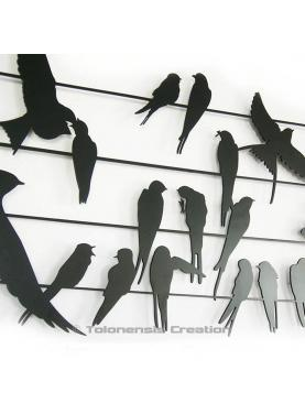 The bird metal wall ornament. Width 90 cm