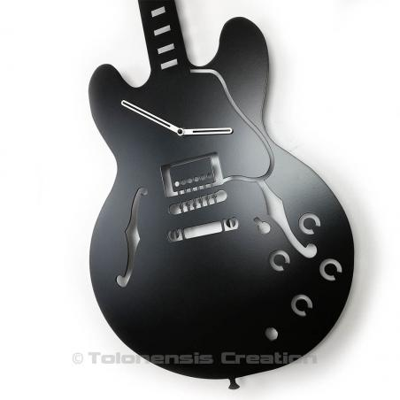 Close-up of the aluminium white hands of the guitar clock Gibson ES-335 wall decoration. Height 90 cm
