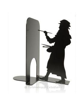 Serre-livres Marie Curie au travail avec son électromètre piézoélectrique. Hauteur 19 cm